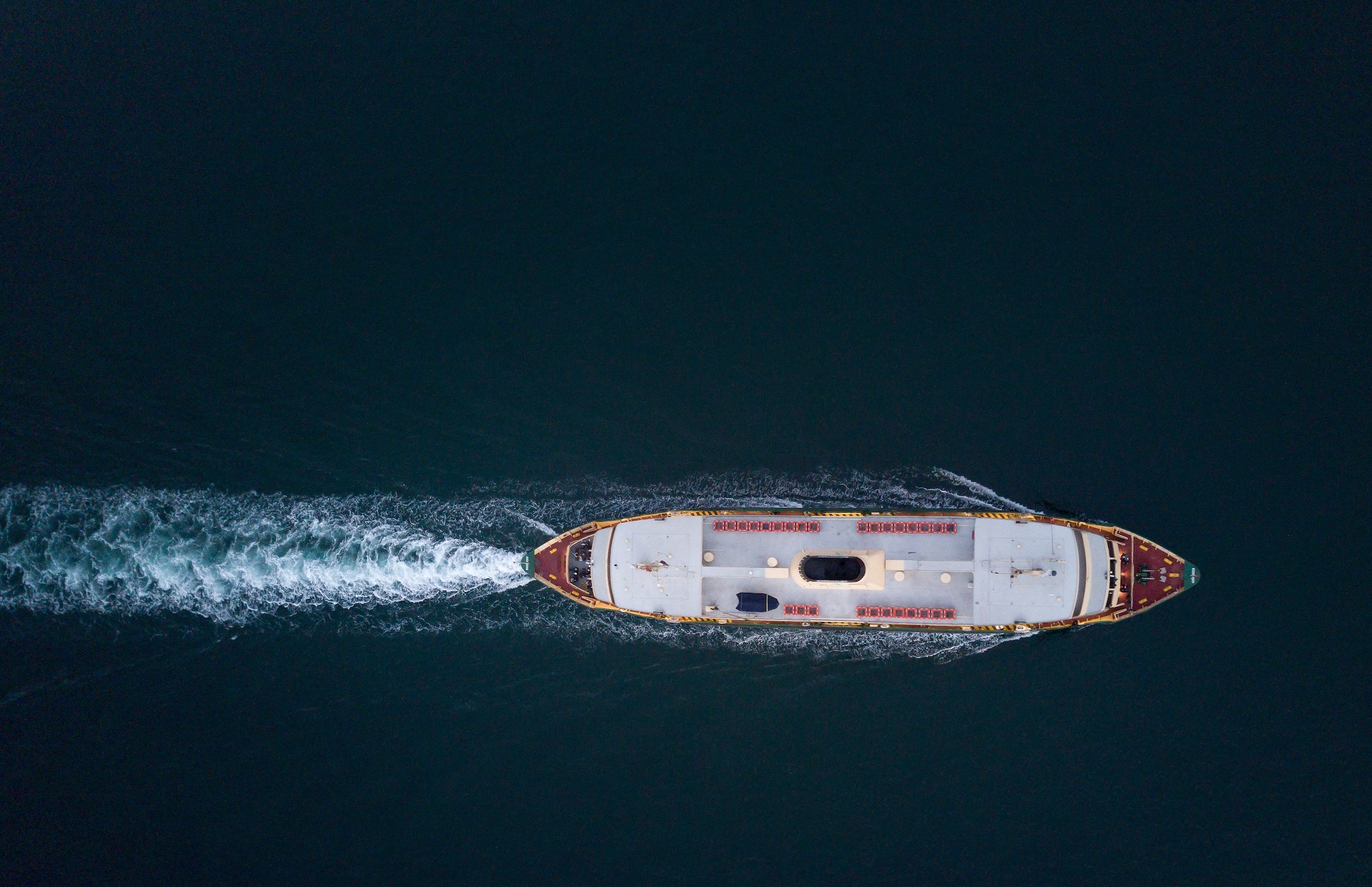 aerial-view-of-ship-on-body-of-water-1556991