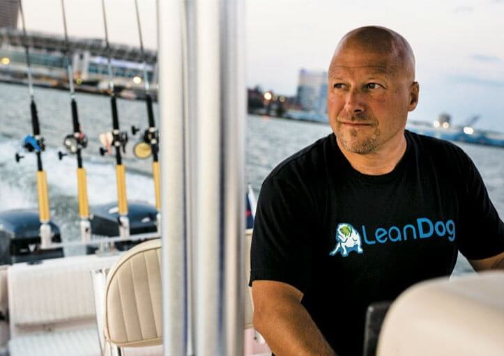 Jon Stahl LeanDog CEO president and cofounder on a boat in Cleveland