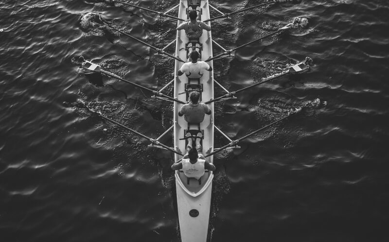 Transformations - crew rowing together grayscale